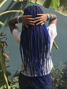 THE GIRL WITH THE BLUE BRAIDS